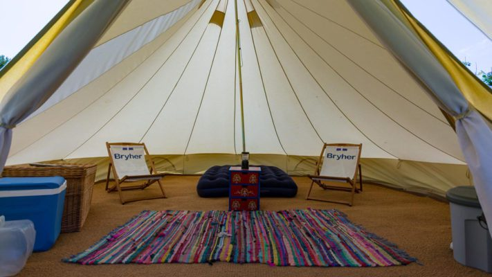 Inside of rented Bell Tent on Bryher Campsite with airbeds, chairs and rug