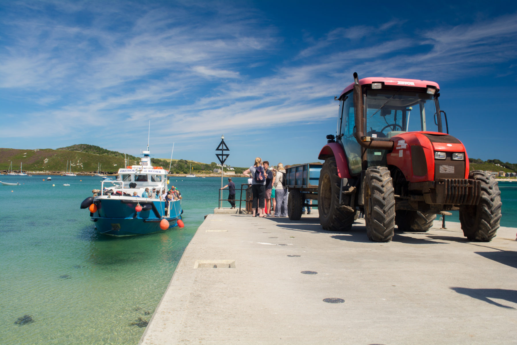 Tractor collecting luggage for campsite on Bryher Isles of Scilly