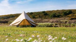 Bryher Campsite Bell Tent sides can be rolled up on a sunny day to let the outside in