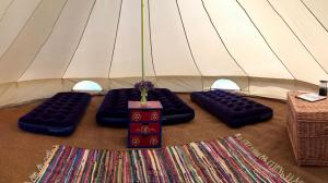 Inside one of our Bryher Campsite Bell Tents