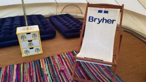 Our Bell Tents include four beautiful, handmade deckchairs for use inside or out