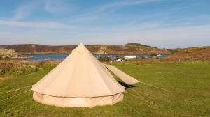 Bell Tent overlooking Tresco Channel on Bryher Campsite